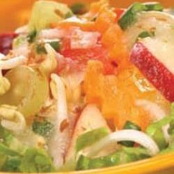 Raw orange, apple and cucumber salad